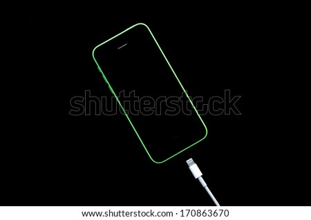 smart phone recharging battery - stock photo