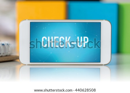 Smart phone which displaying Check-Up - stock photo
