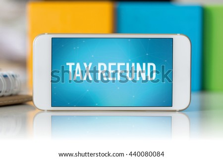 Smart phone which displaying Tax Refund - stock photo