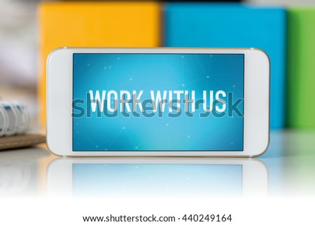 Smart phone which displaying Work With Us - stock photo