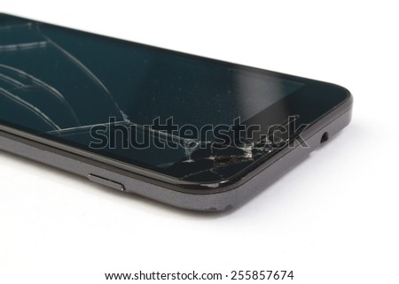 Smart-phone with a broken display screen - stock photo