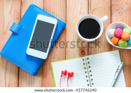 Smart phone with blank notebook and pen, coffee cup texture background for your design, business concept - stock photo