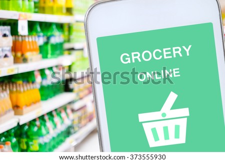 Smart phone with grocery shopping online on screen over blur supermarket background, retail business and technology concept - stock photo