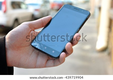 Smart phone with screen cracked in the corner