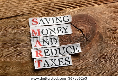 Smart -Saving Money And Reduce Taxes  acronym in business concept,