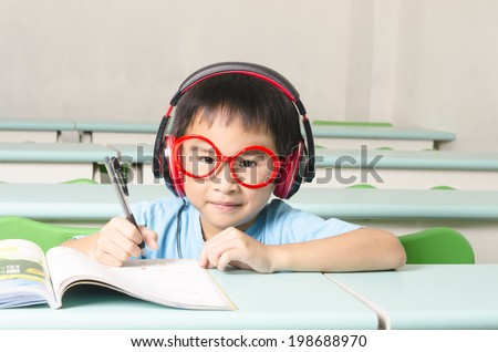 Smart student writing and wearing headphone