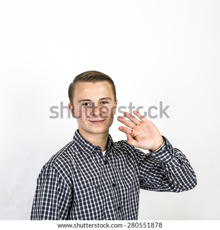 smart teenage boy greets with his hands - stock photo