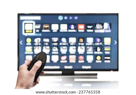 Smart tv UHD 4K controled by hand using remote control.