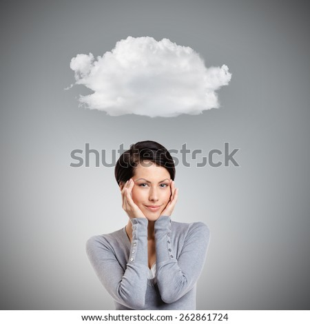 Smart woman admires her own beauty, isolated on grey background with cloud - stock photo