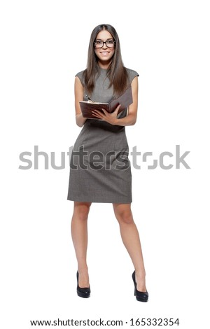 Smart woman in glasses holding clipboard and pen, isolated - stock photo