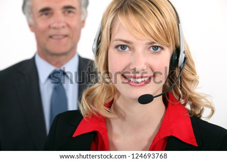 Smart woman wearing a telephone headset - stock photo