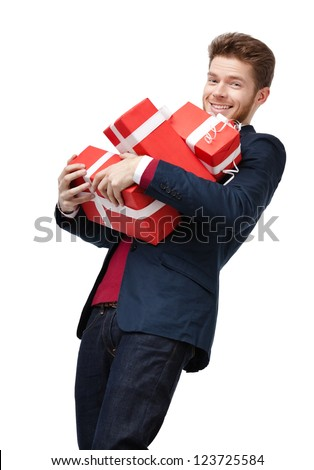 Smart young man carries a lot of heavy presents, isolated on white - stock photo