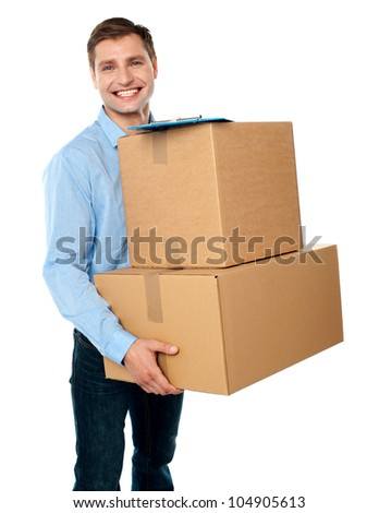 Smart young man carrying boxes with clipboard placed above them