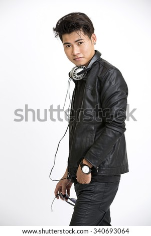 Smart young man in urban style with headphone on white. - stock photo