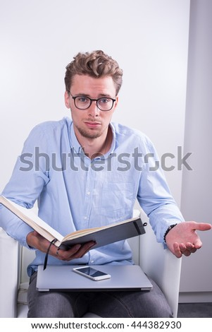 smart young professional with open notebook in his hands
