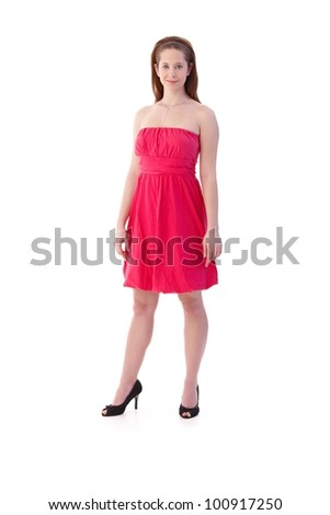Smart young woman smiling in pink summer dress. - stock photo