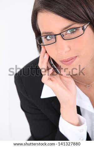 Smart young woman wearing glasses - stock photo