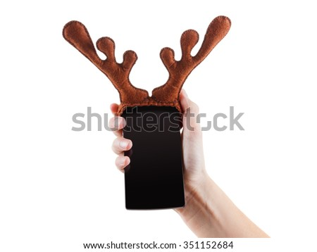Smartphon christmas funny gift concept, reindeer antlers toy in hand, Isolated on white background. Closeup, copy space - stock photo