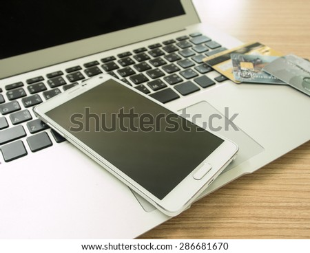 smartphone and credit card  on keybord. shopping online.