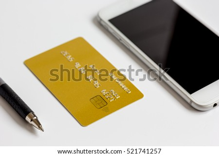 smartphone and credit card on white background online shopping