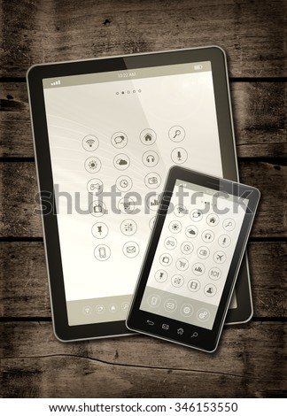 Smartphone and digital tablet PC with desktop icons on a dark wood table - vertical office mockup - stock photo