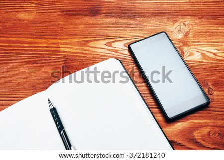 Smartphone and note book with pen