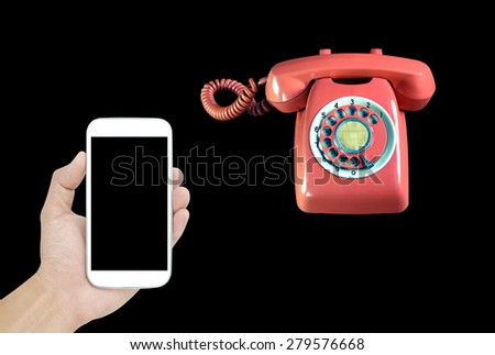 Smartphone and phone vintage on black background - stock photo