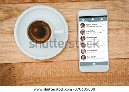 Smartphone app menu against above view of a coffee and a smartphone - stock photo