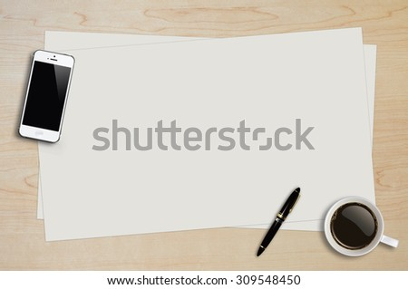 Smartphone, coffee cup, pen and page paper on wood background with copy space - stock photo