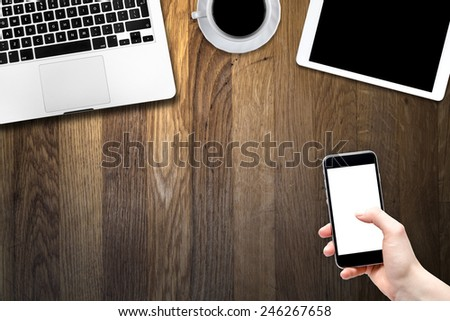 smartphone, digital tablet pc, computer and cup of coffee on wooden table - stock photo
