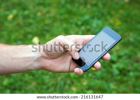 Smartphone hold in the hand