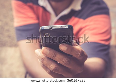 Smartphone in a male's hands