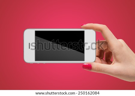 Smartphone in hand. Communication and technology - stock photo
