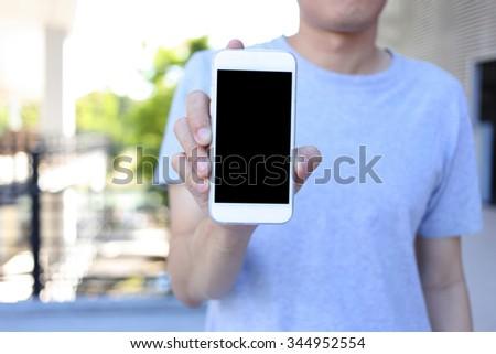 Smartphone in hand, hand holding smartphone - stock photo