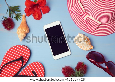 Smartphone mock up template with summer beach items and tropical flowers. View from above. Flat lay - stock photo