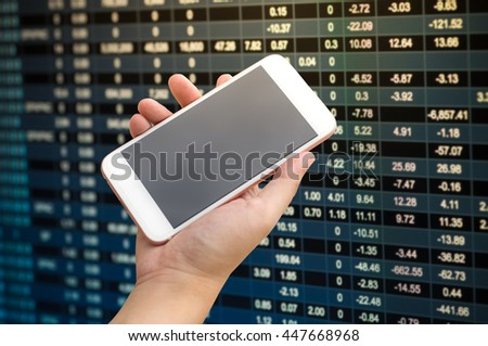 Smartphone on hand with stock market number on screen display - stock photo