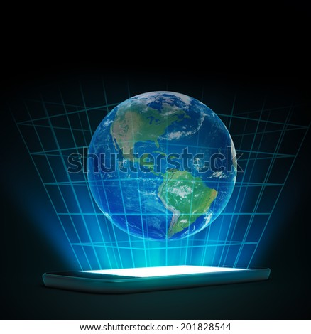 Smartphone or a tablet device with a world hologram - global communication and new media technologies - stock photo