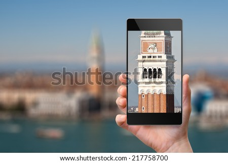 Smartphone photographing Campanile in Venice, Italy - stock photo