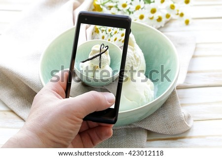 smartphone shot food photo - vanilla ice cream with natural vanilla sticks - stock photo