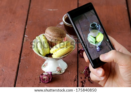 smartphone shot Italian almond macaroons with a cup of espresso - stock photo