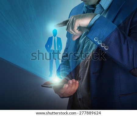 Smartphone shows a virtual screen with a projection of a busines - stock photo