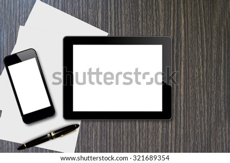 Smartphone, tablet, pen and page on wood background with copy space and text space - stock photo