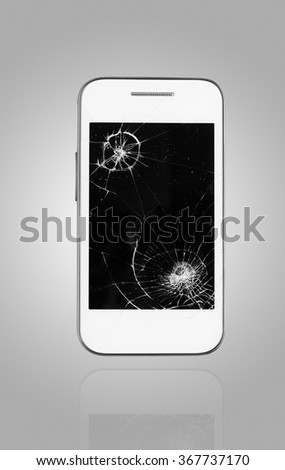 Smartphone with broken screen on graphical background - stock photo