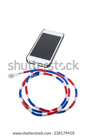 Smartphone  with cable charger on white background - stock photo