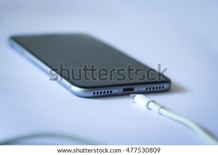 Smartphone with charger.