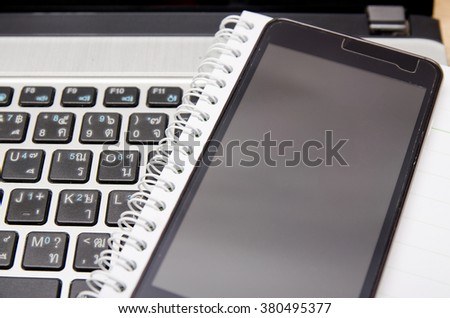 Smartphone with computer and notebook