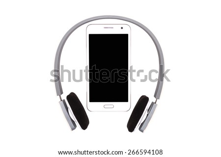 Smartphone with headphones on white background, blank screen on the phone - stock photo