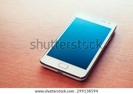 Smartphone with turned off screen - stock photo