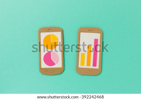 Smartphones with graphs and charts - report dashboard concept - stock photo