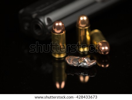 smashed bullets and handgun or pistol